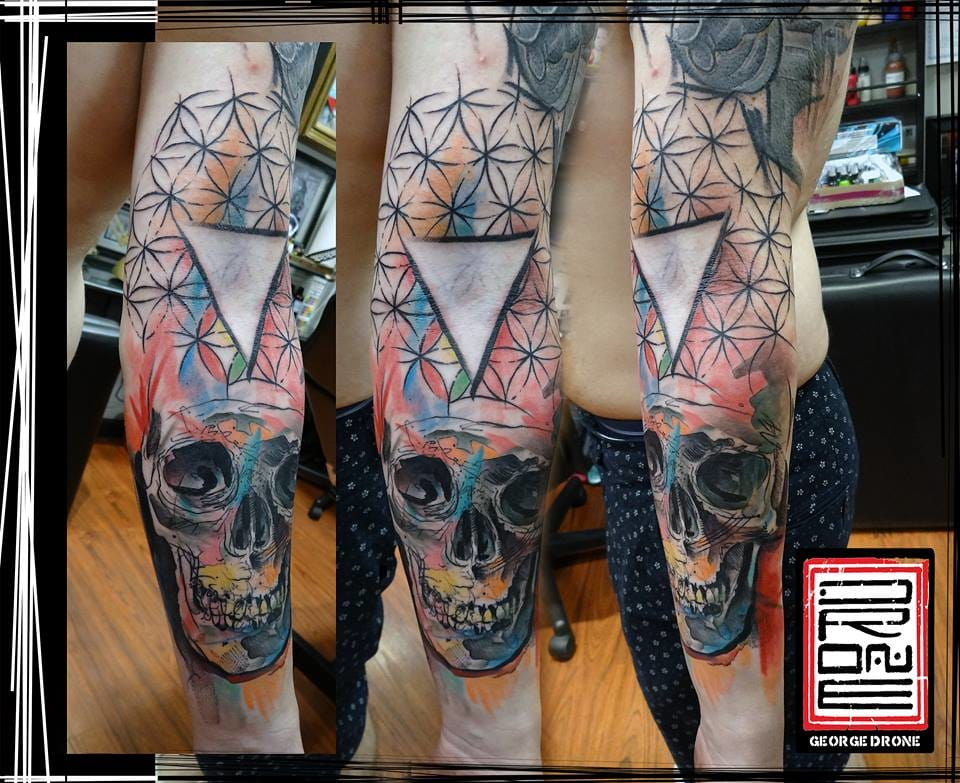 Colourful geometric skull tattoo by George Drone.