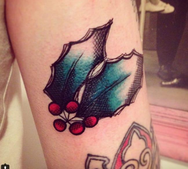 Holly leaf tattoo by Cassandra Bruni (Instagram @lapetiteink).