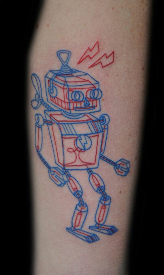 Cool red and blue wind up toy tattoo by Tuula.