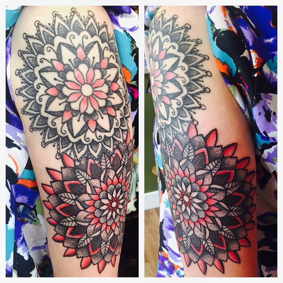 Black and red mandalas on the arm.