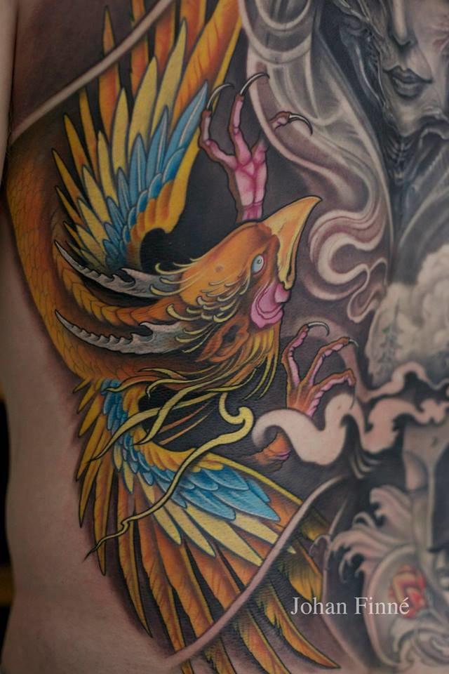 A detail on a gorgeous phoenix tattoo by Johan Finné. #phoenix #johanfinne