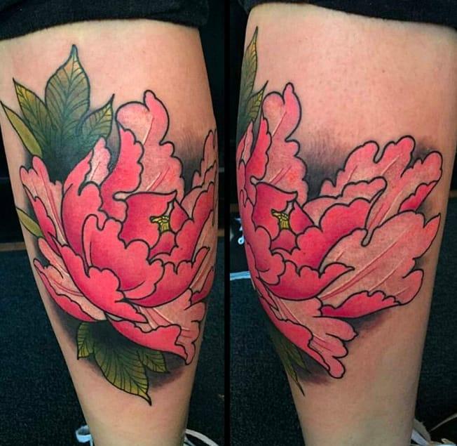 Stunning peony knee tattoo by Brock, Red Door Tattoo (Instagram @reddoortattoo).