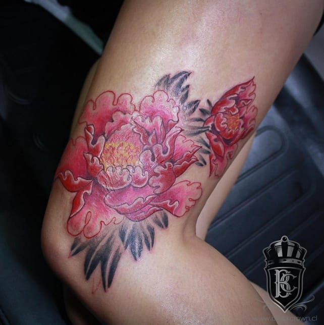 Bright red peony to cover a burn on this client, by Vito Calaveras (Instagram @vito_klvr).