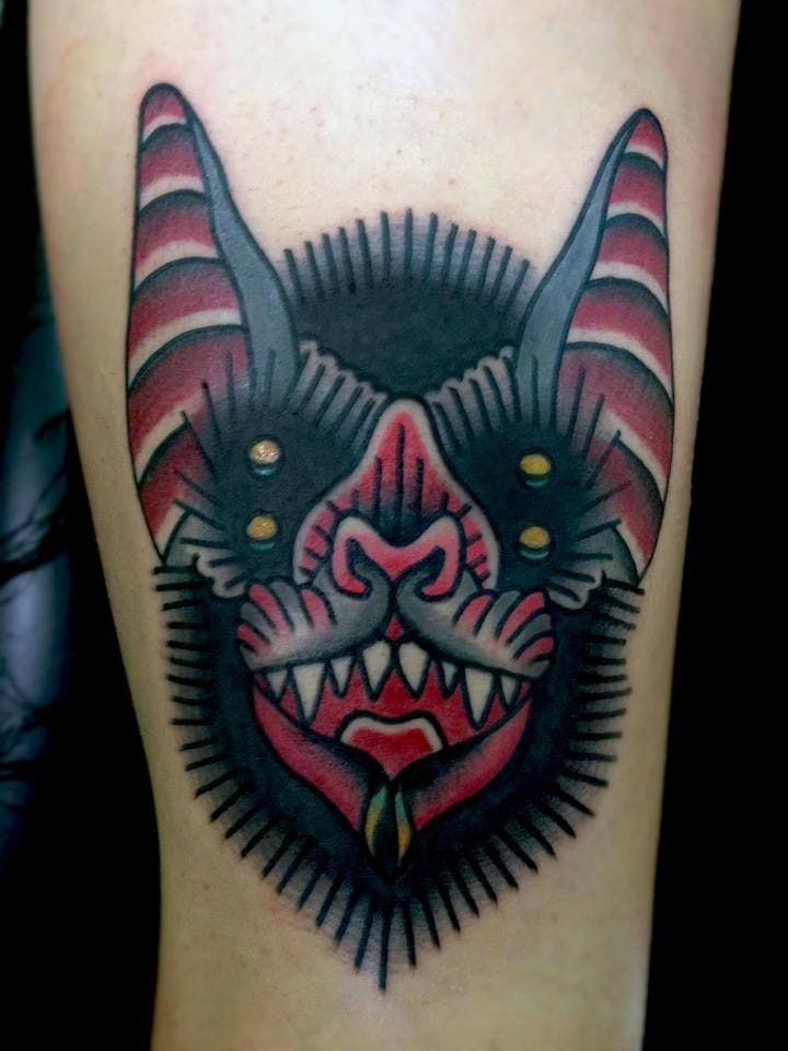 Traditional Bat tattoo, lovin' the bold lines and black on this tattoo.