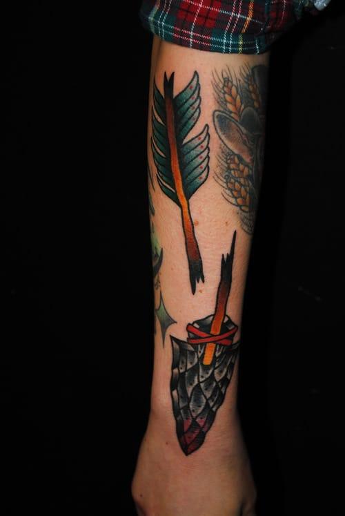 Solid looking broken arrow tattoo.