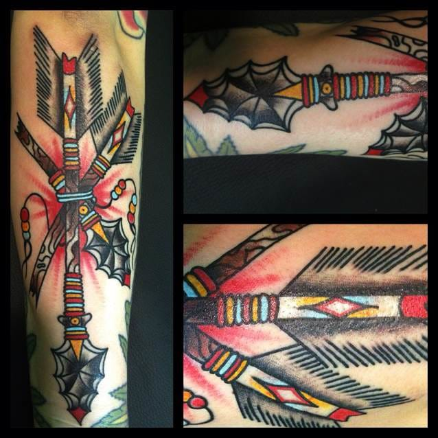 Insane looking arrow bundle tattoo. Crispy lines and solid color.