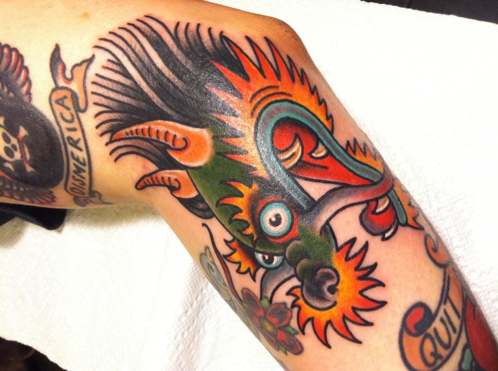 10 Old School Dragon Head Tattoos That Truly Look Classy