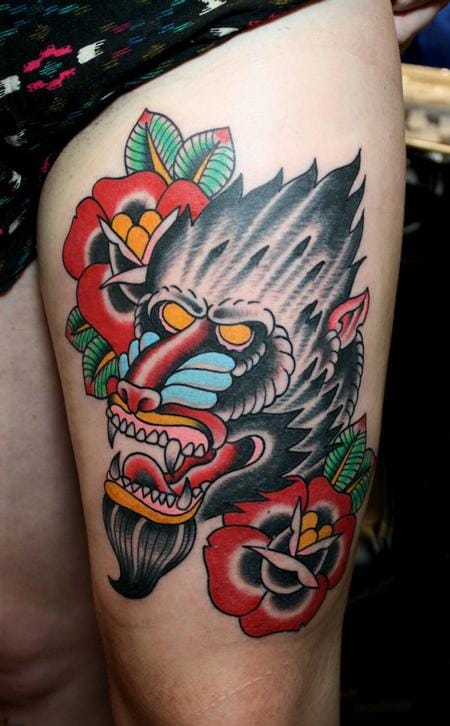 Traditional mandrill baboon tattoo. Heavy black and vibrant colors!