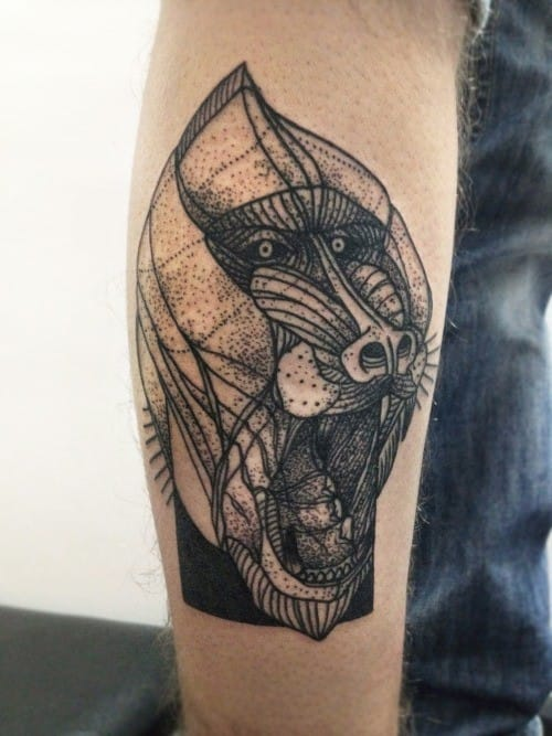 A fresh take on this illustrative baboon tattoo.