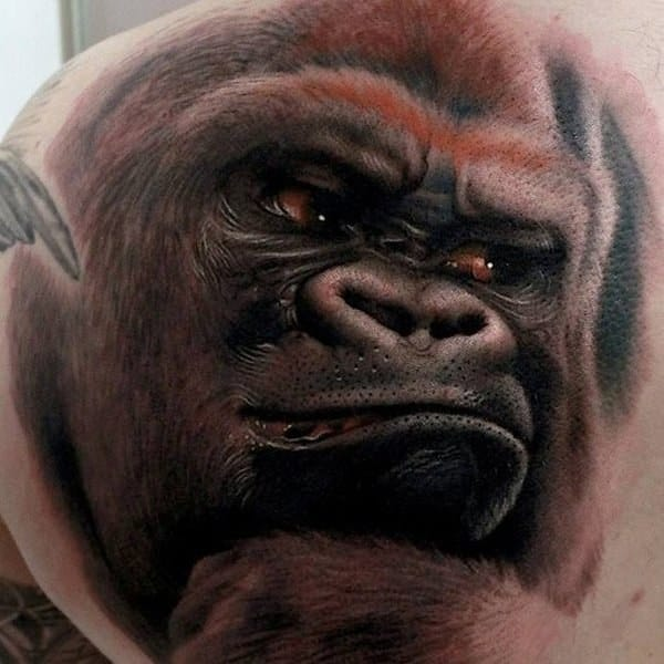 Really cool looking grinning gorilla tattoo by Ivan Stank-Hanz