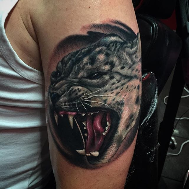 Fierce Snow Leopard Tattoo by Dave Lue