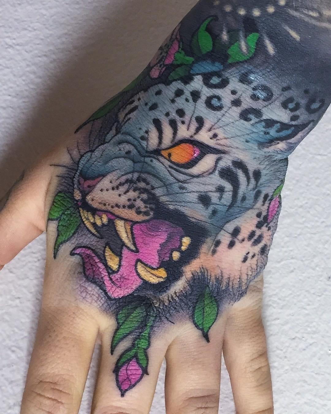 Snow Leopard Hand Tattoo by Peter Lagergren