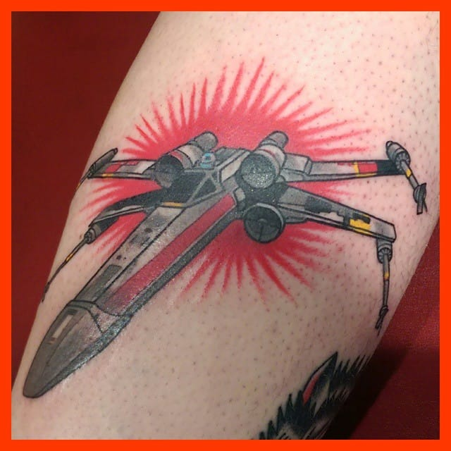 Simple yet solid X-wing fighter tattoo.