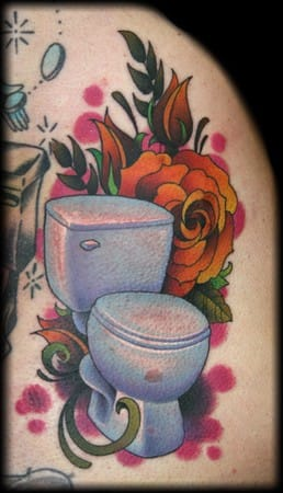 This beautiful rendition of the Toilet bowl, with a rose and all, gives the toilet bowl tattoo justice!