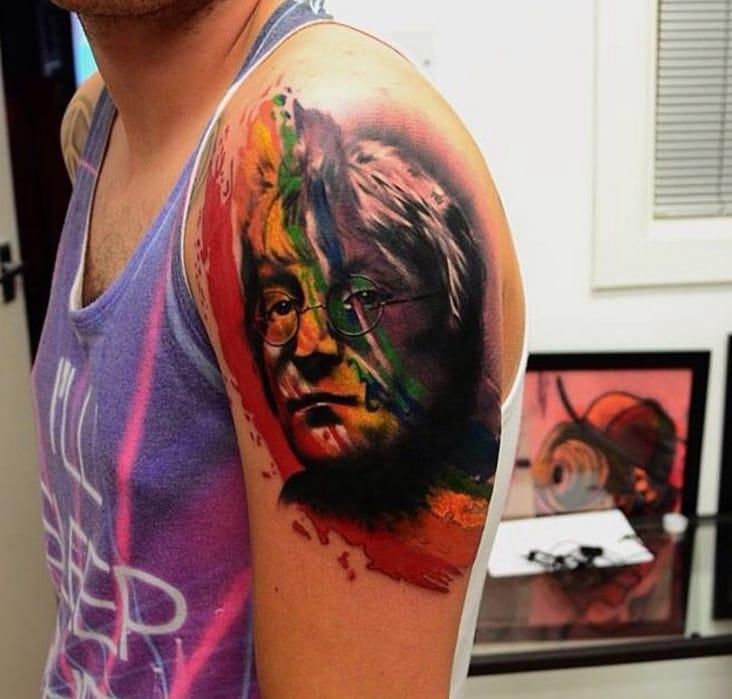 John Lennon (English singer and songwriter and co-founder of The Beatles) tattoo by Bart Janus, Dundee, UK (Instagram @bartjanus).