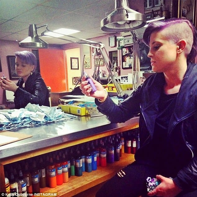 So here's Kelly back in 2014 at Shamrock Social Club, checking out some possible ink colors for her new tattoo.
