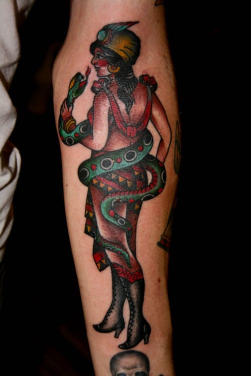 Cool Traditional Snake charmer tattoo.