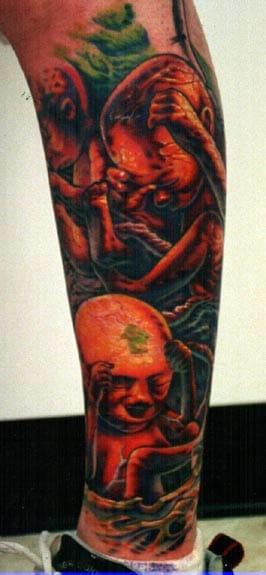 Fetus tattoo, artist unknown.