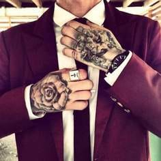 suit and tattoos