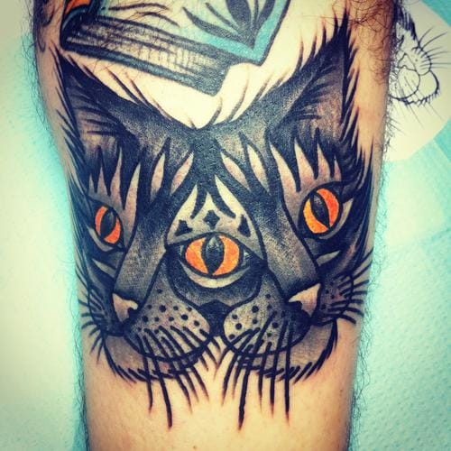 Cool concept on this cat head tattoo.