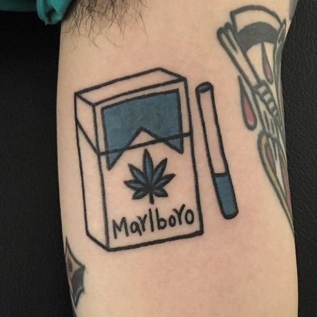 Quirky cigarette tattoo