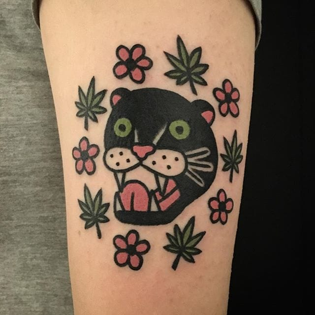 Quirky panther head tattoo