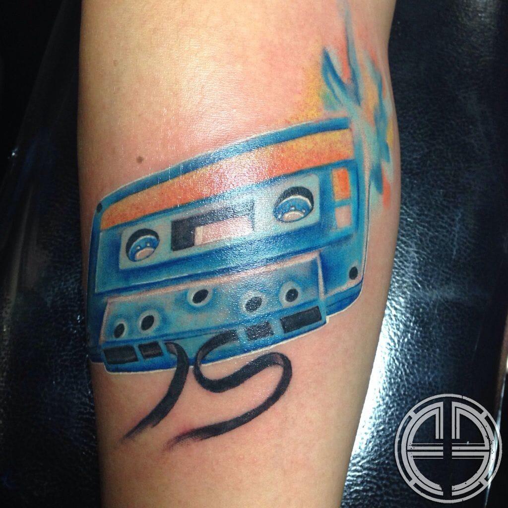 Nice colored cassette tattoo.