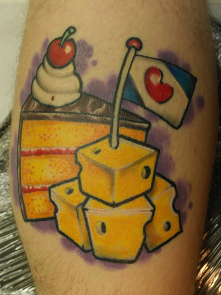 Cake and cheese what more do you want in life? Cheesy tattoo by The Underline Tattoo