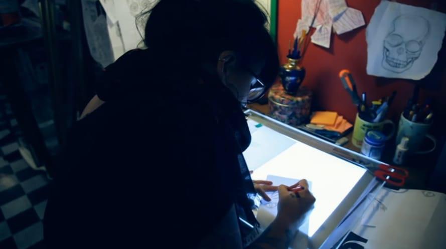 Tattoo artist Jules McCay gets Nolan's design ready.