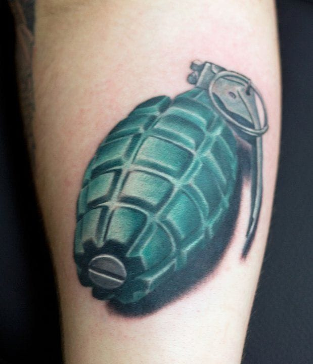 Colored grenade tattoo. Really clean work.