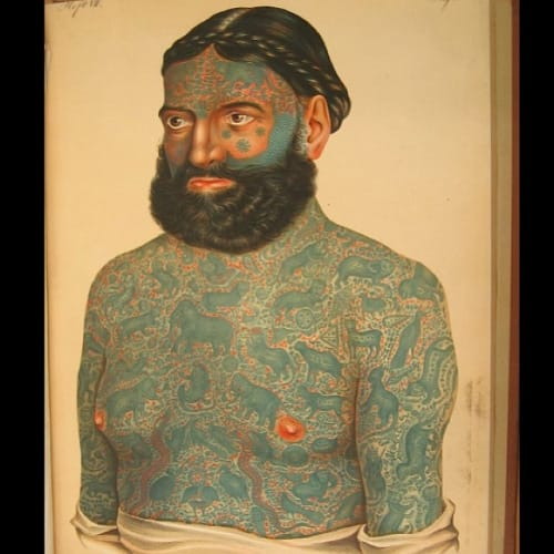 Captain Costentenus known as The Tattooed Prince whose tattoo designs were blue and red in color from a Burmese origin and depicted mostly animals native to Burma and eastern mythology