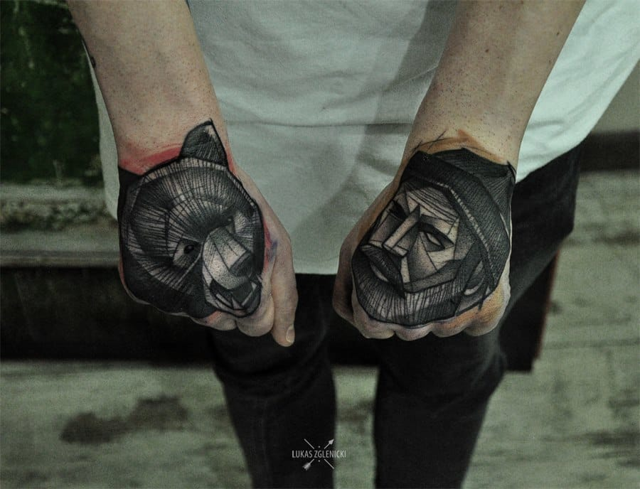 Black & Bold Sketch Style tattoo perfectly placed on the hands by Lukas Zglenicki.