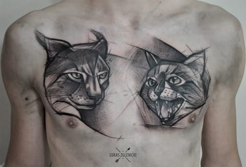 Bold & simple sketch style blackwork on the chest by Lukas Zgelnicki.