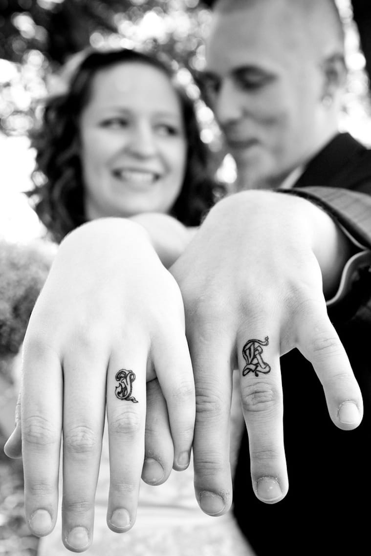 Some couples prefer to get permanent wedding rings. Thank god for tattoos! Here's a simple idea with each other's initials on.