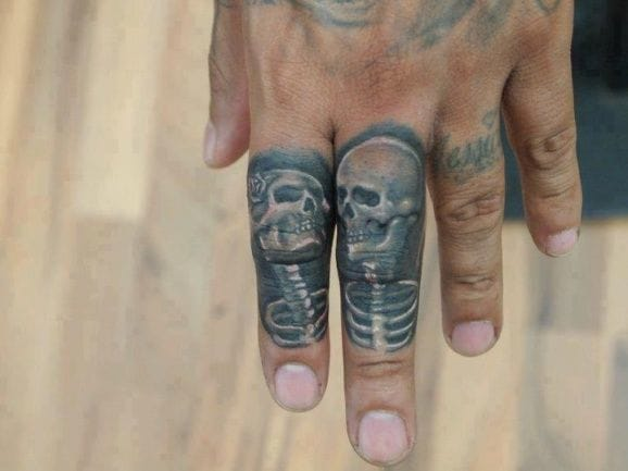 Nicely done small piece Til Death Do us Part Tattoo on the fingers!
