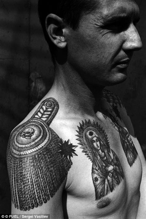 An old Russian mafia tattoo shot by Sergei Vasiliev. The epaulette means that this guy was an important thief in the gang. The skull in the centre of the epaulette can stand for: 'I am not and will never be a slave, no one can force me to work'.