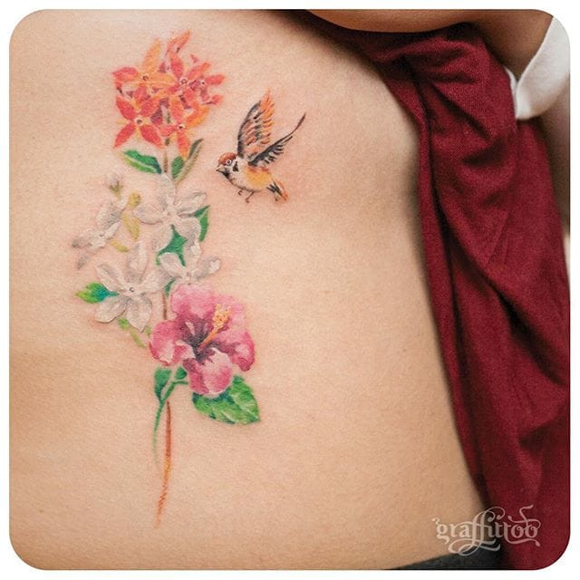 Nature inspired little tattoos look awesome. Tattoo of flowers and a bird. #delicate #graffittoo #bird #floral #flower #nature #color