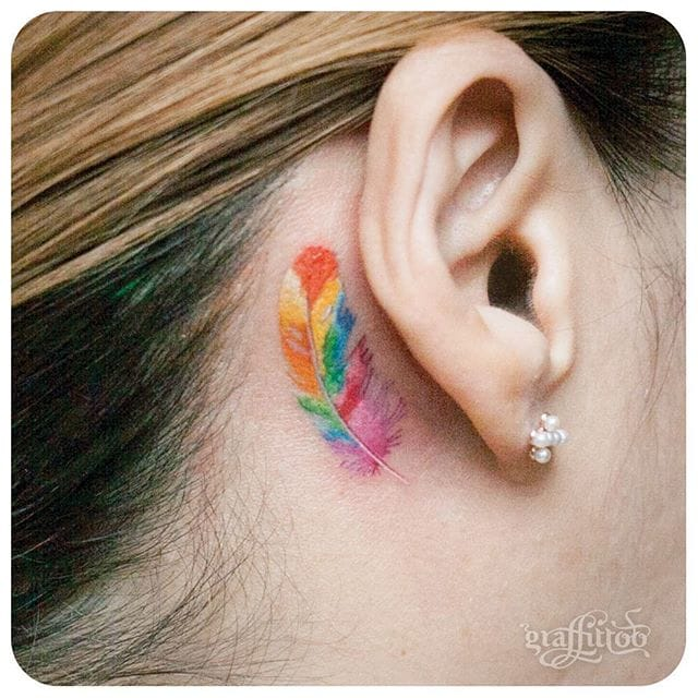Solid little tattoos behind the ear could be a great tattoo choice for girls. Colorful feather. #delicate #graffittoo #colorful #feather