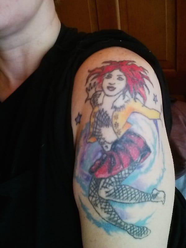 Dancing girl tattoo, artist unknown.