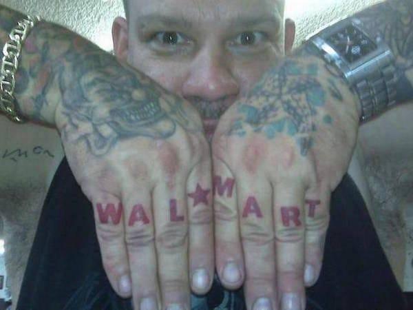I hope he gets discounts! Walmart finger tattoo, artist unknown