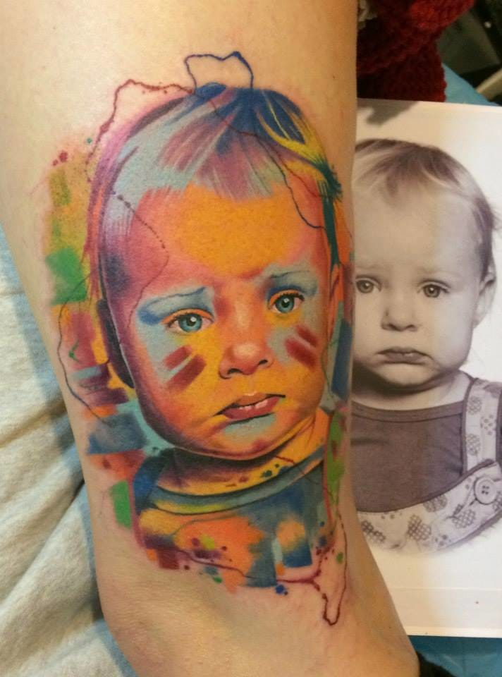 Colorful child portrait tattoo by Dzikson Wildstyle /Photo from Instagram @dzikson_tattoos