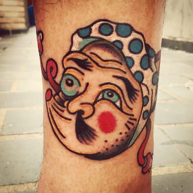 Hyottoko Tattoo by Rafael Kendi