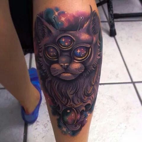 Love this galactic three eyed cat tattoo! Unknown artist
