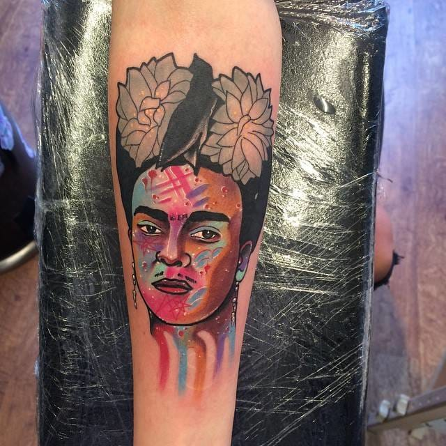 Neotraditional and watercolor style portrait tattoo