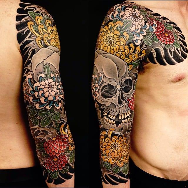 Skull and flower tattoo sleeve #ReginoGonzales