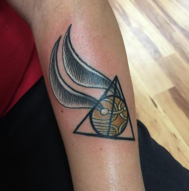 Golden Snitch by tattooist and Harry Potter superfan Cynthia Finch (Instagram @cyncityink).