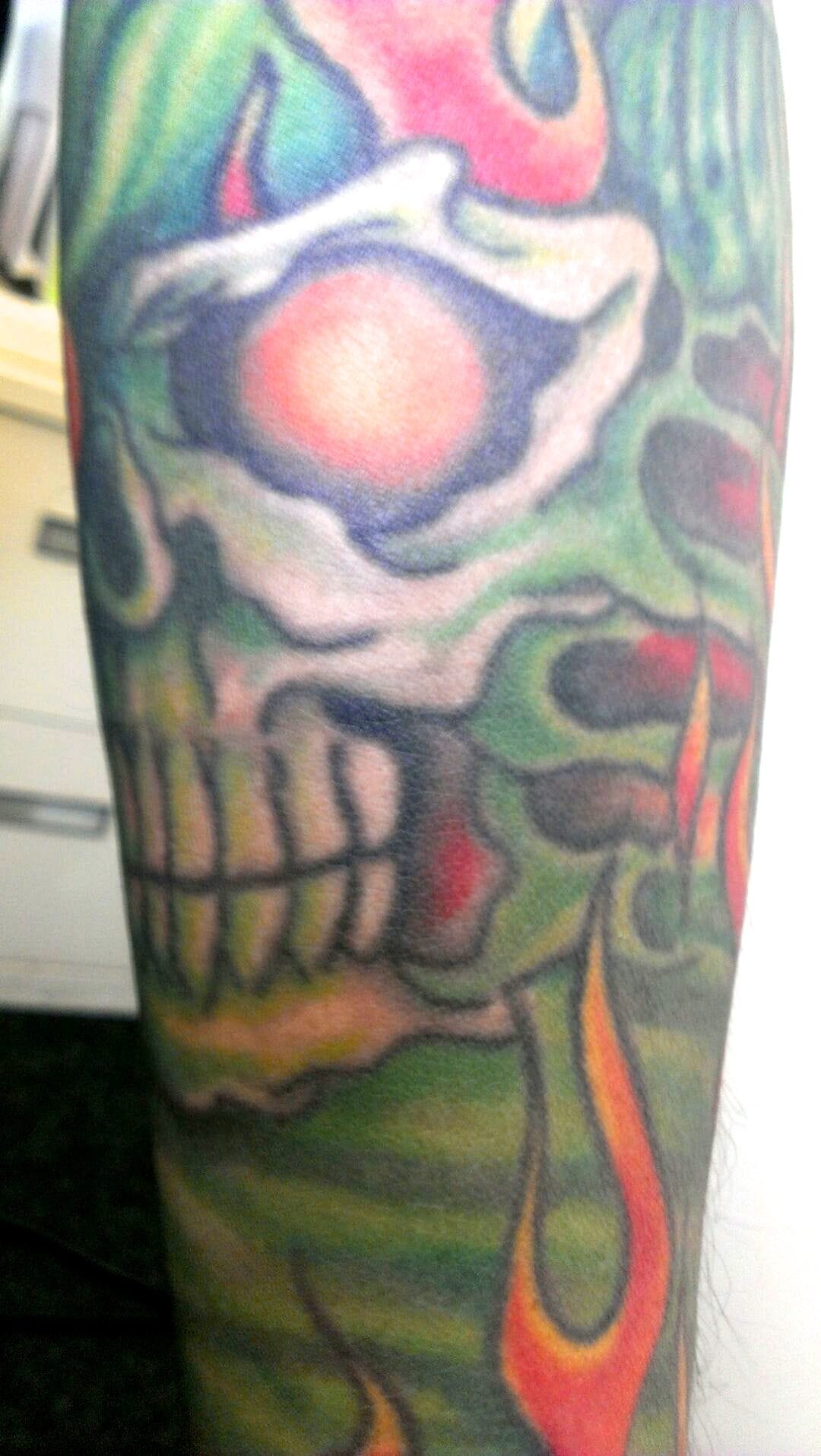 20 year old tattoo by Ray Youngman, recolored 10 years ago by Hannah Aitchison.