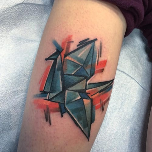 Cool rendition of the paper crane tattoo by Hollywood, Skintricate Tattoo Company