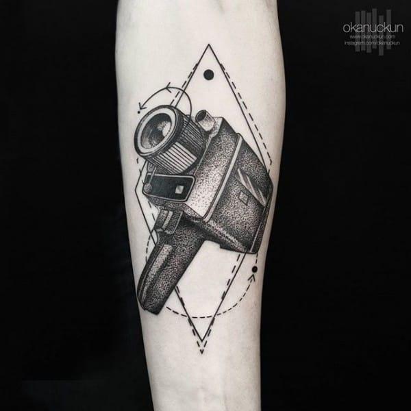 Vintage camera contemporary tattoo by Okanuckun
