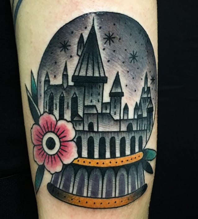 Hogwarts in a snow globe tattoo by Instagram @manuel_sierra_tattoo.